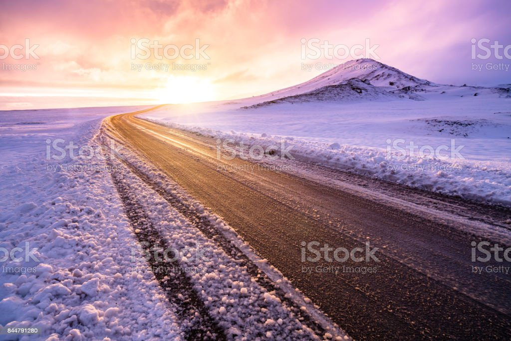 Winter sunset view on the road trip stock photo