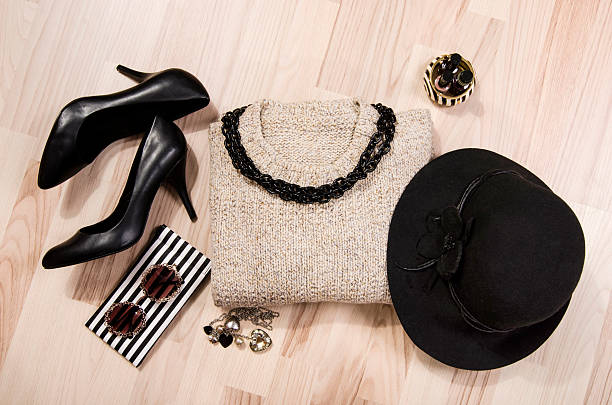 Winter sweater and accessories arranged on the floor. stock photo