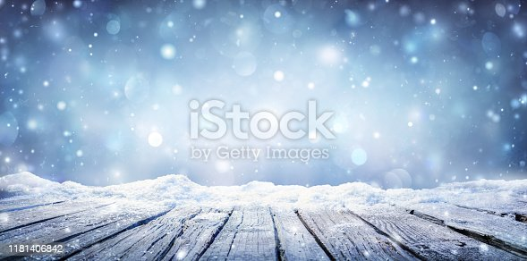 Wooden Plank With Snowing In The Snowy Sky