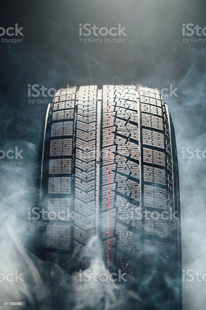 winter tire in smoke stock photo
