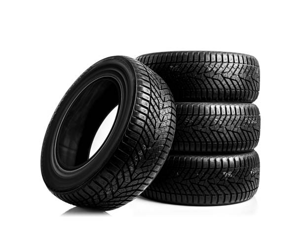 winter tires on a white background - four people stock photos and pictures