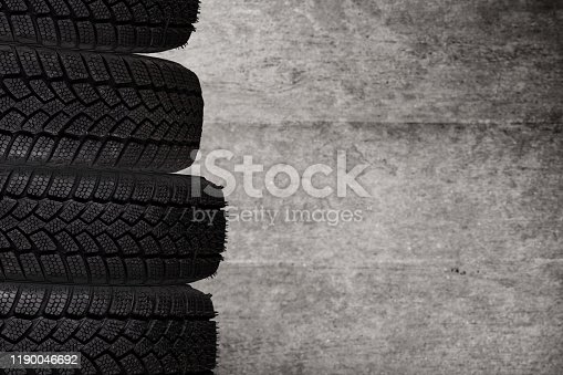 Winter tires texture background, close-up.