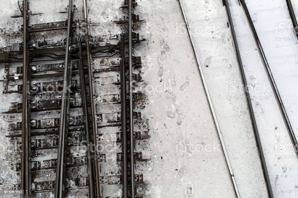 Winter top view on railway tracks and switch in snow background royalty-free stock photo