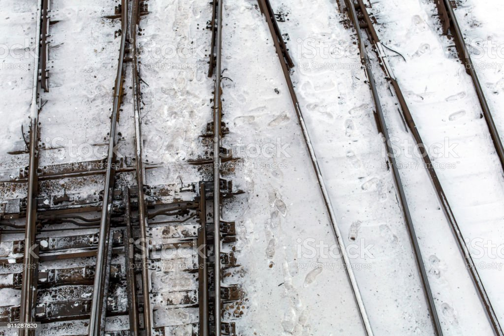 Winter top view on railway tracks and switch in snow background stock photo