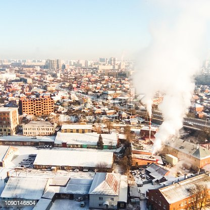 istock Winter town. Frosty sunny day in the city. Snow on the streets a 1090146804