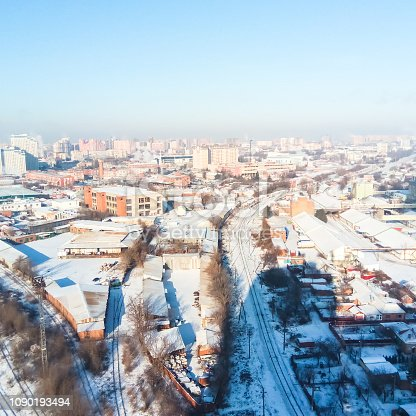 istock Winter town. Frosty sunny day in the city. Snow on the streets a 1090193494
