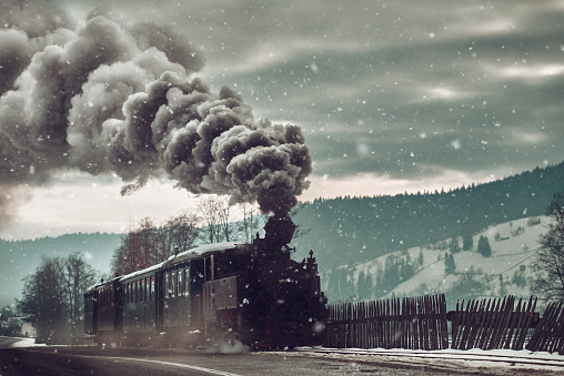 winter time with vintage train with gray smoke.