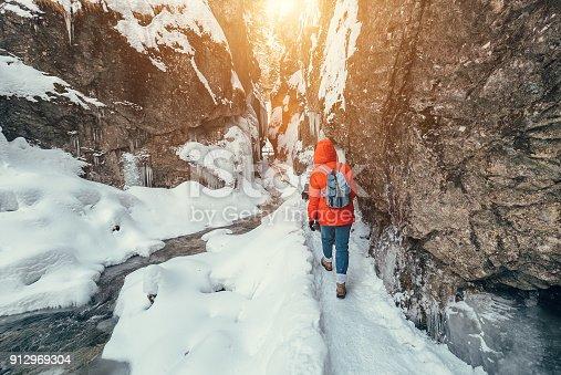 istock Winter traveler in snow mountain canyon 912969304