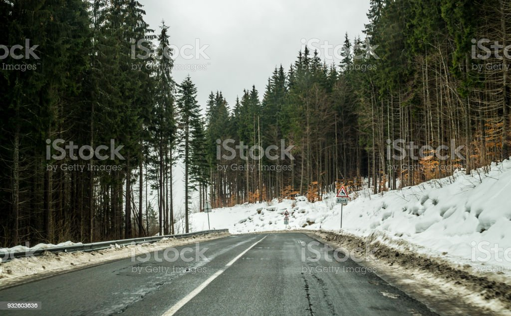 Winter trip by car. A sharp turn on the road in the mountains stock photo
