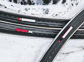 Semi trucks on a multi-lane highway.