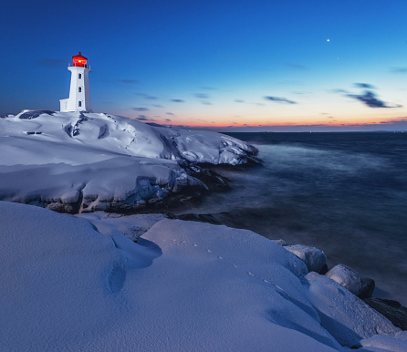 Peggy's Cove Lighthouse in deep twilight.  Venus and Mars shine at right of the frame.  Long exposure.