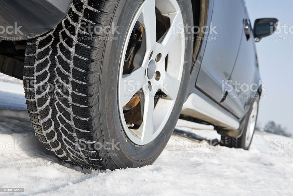 Winter tyres wheels installed on suv car outdoors stock photo