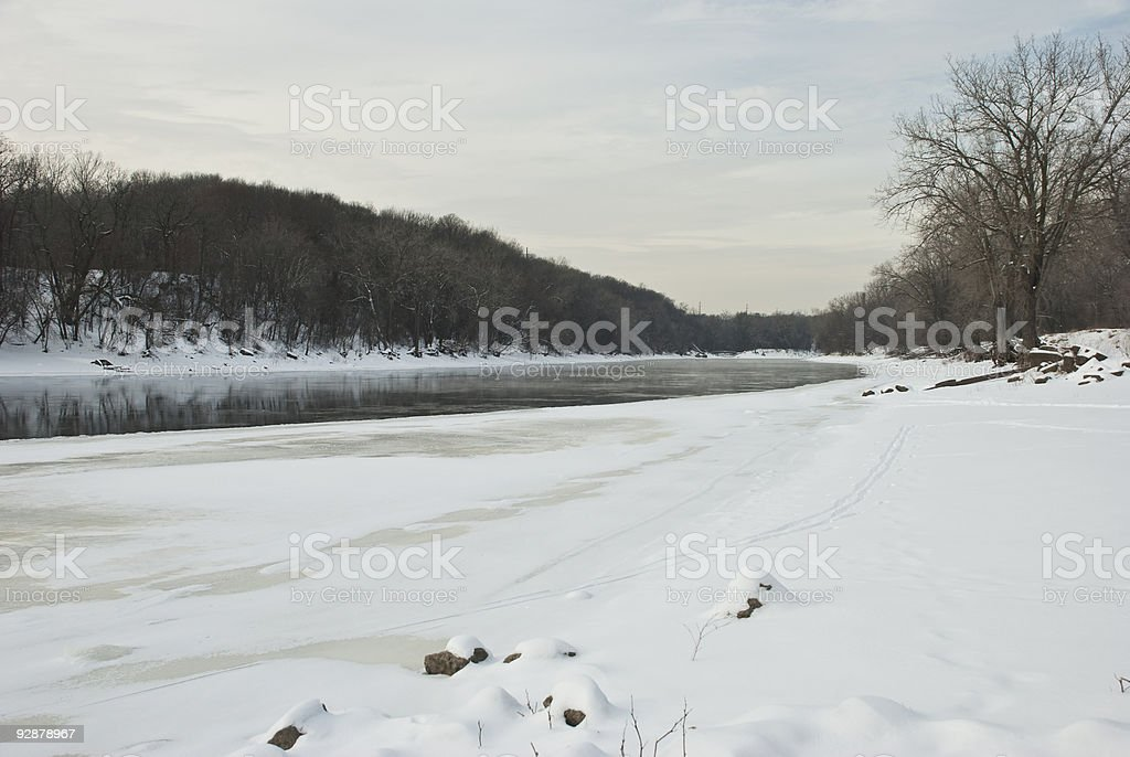 Winter view of a Mississippi River Along Snow Banks stock photo