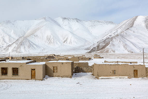 Winter view of a village in mountains stock photo
