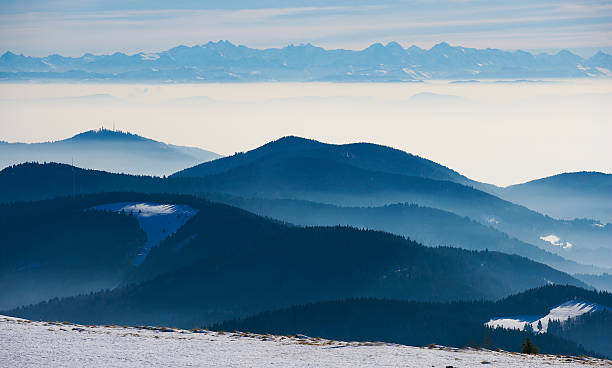 Winter view of black forest landscape until the swiss alps View of the mountain Belchen in upper black forest black forest stock pictures, royalty-free photos & images