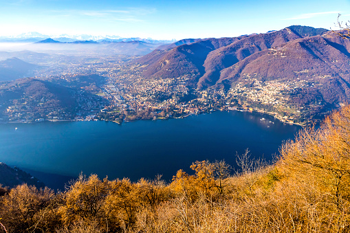 Winter skyline of Como Lake. View from Volta Lighthouse viewpoint, Brunate village, Como, Lombardy province, Italy. Swiss Alps on the background