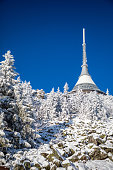 istock Winter view of mountain top hotel and television transmitter Jested in Liberec, Czech Republic 1199285954