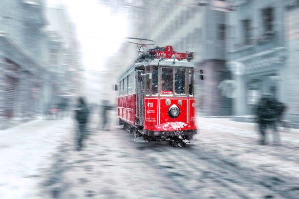 Cтоковое фото Winter view of nostalgic red Tram and people in daily life