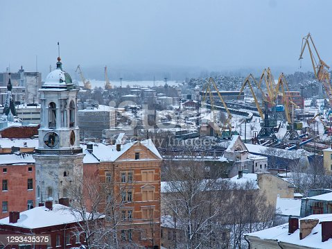 Winter view on snow covered roofs of Vyborg city buildings, Russia