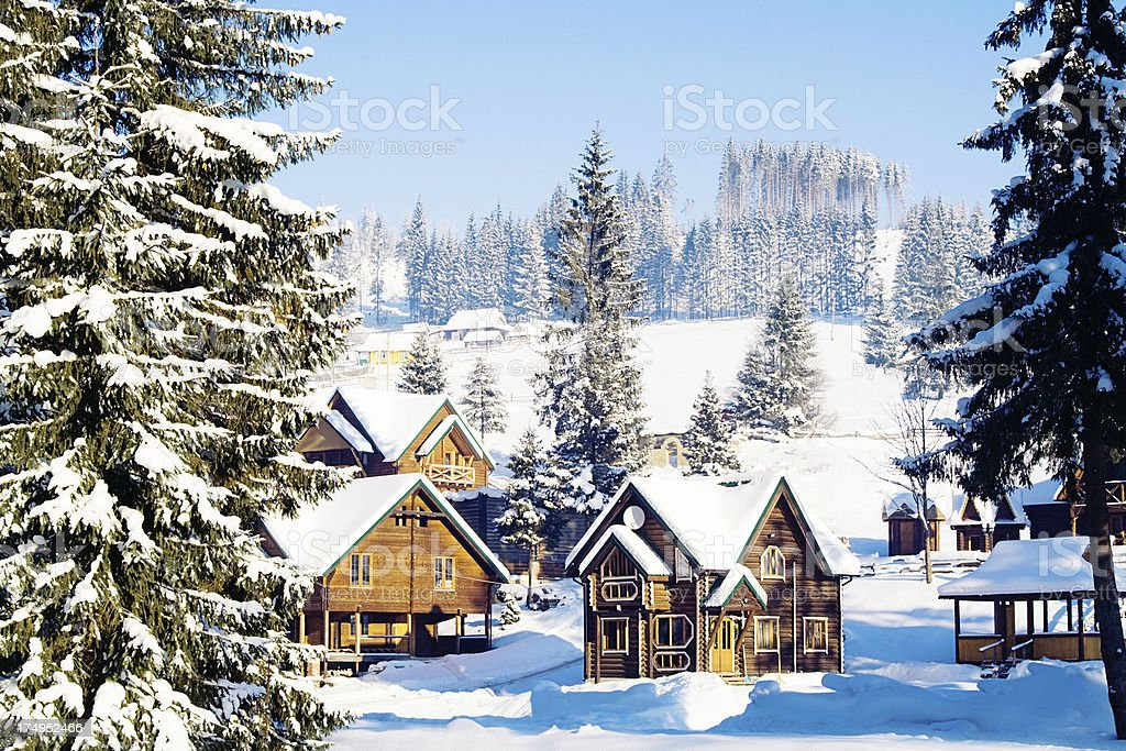 Winter village in mountains stock photo