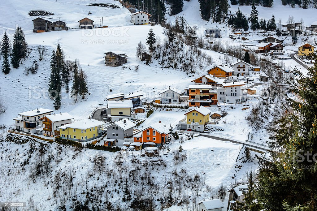 Winter village with colourful cottages in suburb of Ischgl, Austria. stock photo