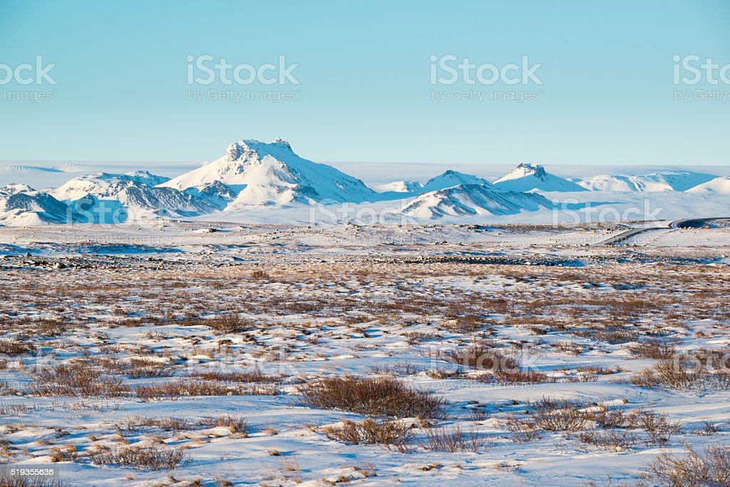 Winter volcanic landscape with mountain range near Langjokull, Iceland stock photo
