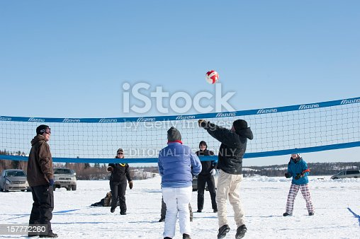 Yellowknife, Canada - March, 20 2010:  Men and women dressed for the cold enjoy a fun game of volleyball in late winter on the ice of Great Slave Lake.