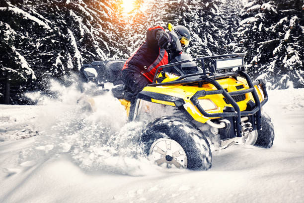 Winter walk on the quad bike in the forest. stock photo