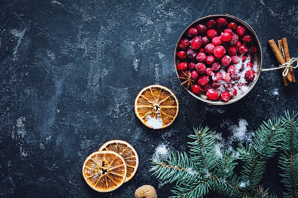 winter wallpaper background with pine tree, cranberry - cranberry stock photos and pictures