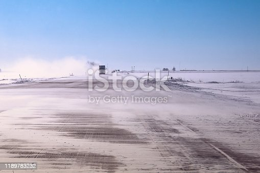 1127834626 istock photo Winter wind and blowing snow on a major highway 1189783232