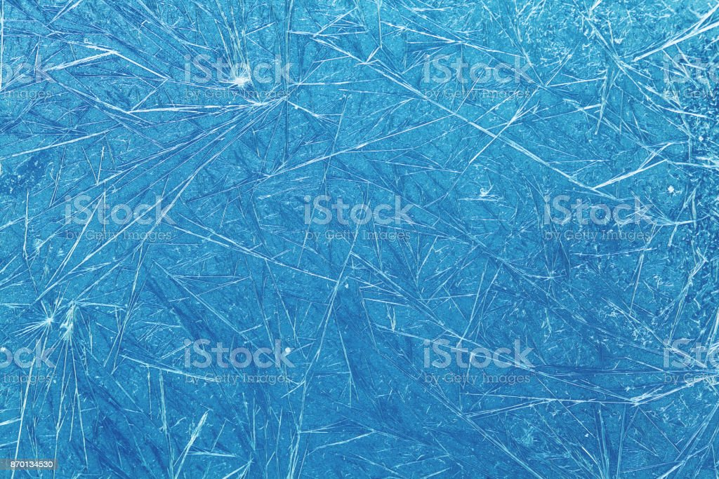 Winter window ice flowers pattern background. cold weather concept. soft focus shallow depth of field stock photo