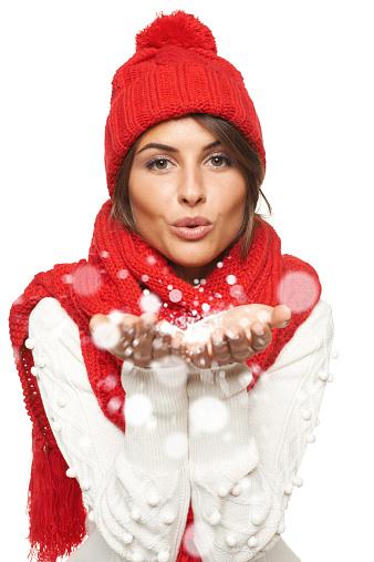istock Winter woman blowing snow 523110985