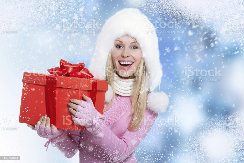 winter woman hold gift box royalty-free stock photo