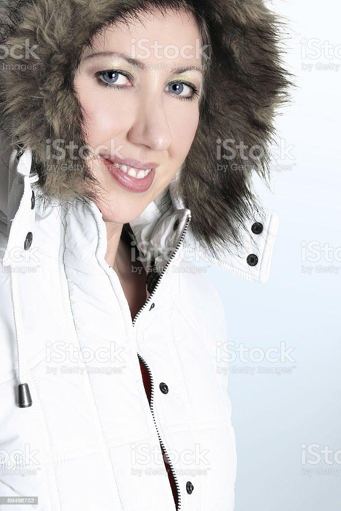 Winter woman in a hooded parka royaltyfri bildbanksbilder