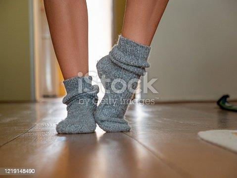 istock Winter, woman on socks. 1219148490