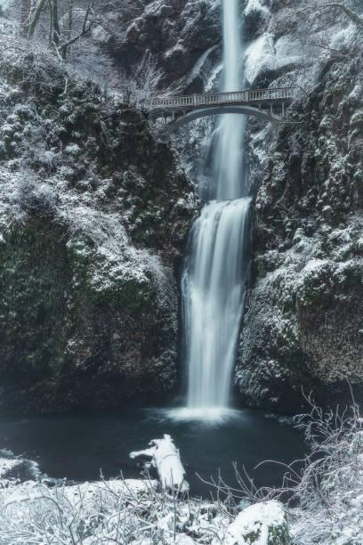Winter wonderland at snowy and icy Multnomah Falls, Oregon stock photo