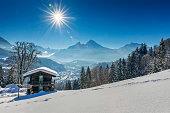 Panoramic view of beautiful winter wonderland mountain scenery in the Alps