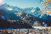 Wonderful panorama of Garmisch-Partenkirchen and the German Alps. Here you can see the Wetterstein Mountains with the Alpspitze on the left and Germany's highest mountain Zugspitze on the right behind the Waxensteine.