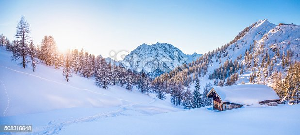 istock Winter wonderland in the Alps with mountain chalet at sunset 508316648