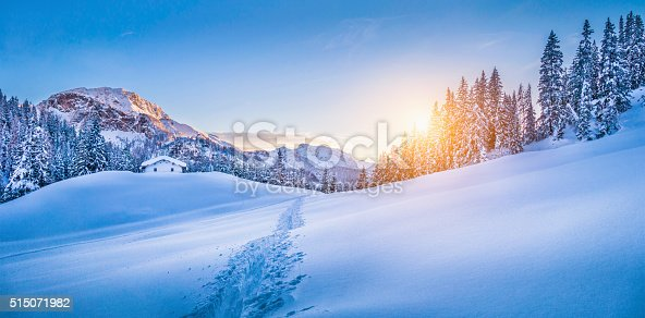 istock Winter wonderland in the Alps with mountain chalet at sunset 515071982