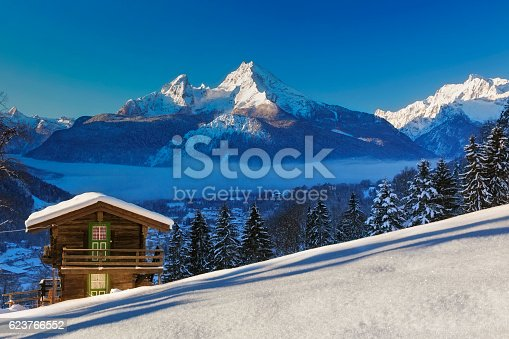 Panoramic view of beautiful winter wonderland mountain scenery in the Alps