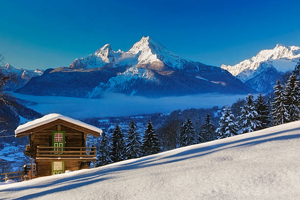 Winter wonderland im Watzmann Land Panoramic view of beautiful winter wonderland mountain scenery in the Alps chalet stock pictures, royalty-free photos & images