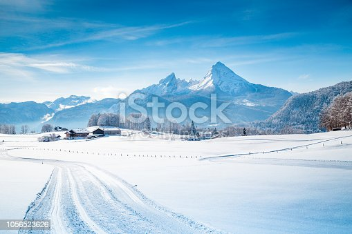 istock Winter wonderland scenery with trail in the Alps 1056523626