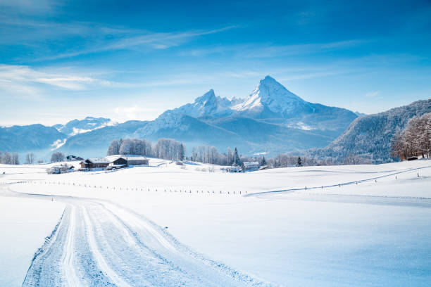 Winter wonderland scenery with trail in the Alps Beautiful winter scenery in the Alps on a cold sunny day with blue sky and clouds bavarian alps stock pictures, royalty-free photos & images