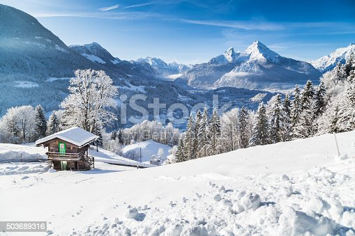 istock Winter wonderland with mountain chalet in the Alps 503689316