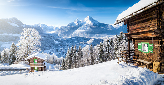 Winter wonderland with mountain chalets in the Alps