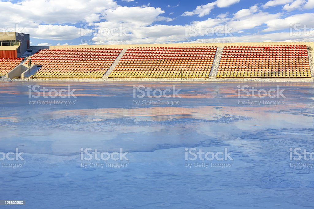 Winter work on filling the stadium with water. Skating stock photo