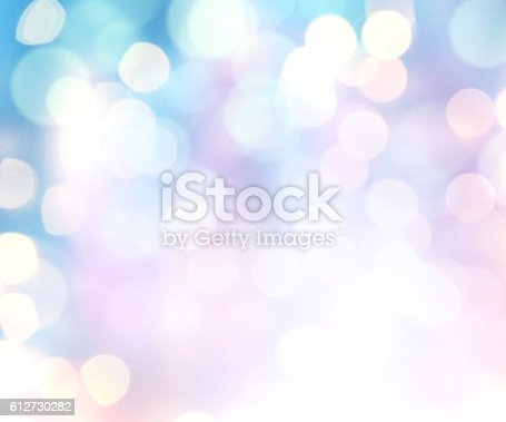 istock Winter xmas holiday blurred lights background. 612730282
