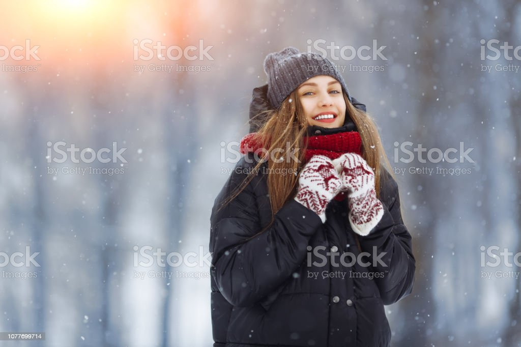 Winter young woman portrait. Beauty Joyful Model Girl laughing and...