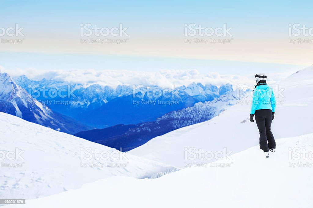 Winter  Young woman snow skier  Alps mountains snowy landscape stock photo